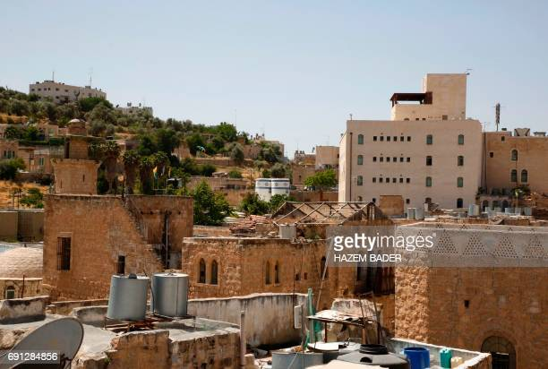 A general view taken on May 8 2017 shows houses owned by Jewish families before the 1967 SixDay war and now occupied by Jewish settlers in the West...