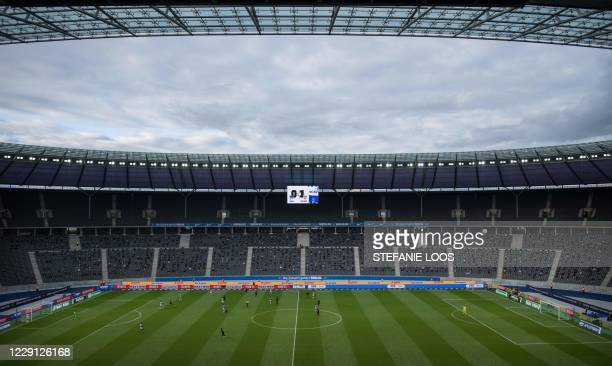 A general view taken on October 17 2020 shows players during the German first division Bundesliga football match between Hertha BSC Berlin and VfB...