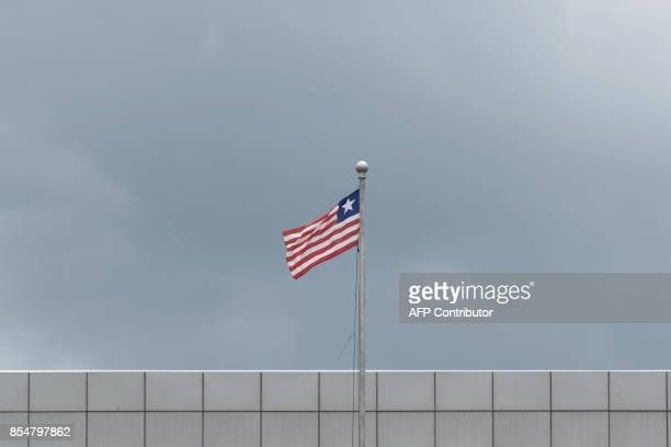 A general view taken on September 27 2017 shows the Liberian Flag on the facade of the Samuel Kanyon Doe Sports Complex in Monrovia Liberia The...
