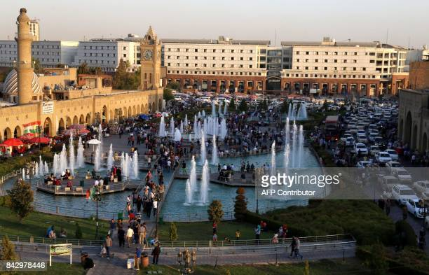 A general view taken on September 5 2017 shows people of the Citadel and the City Park in Arbil the capital of the autonomous Kurdish region of...