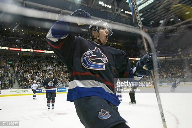 A general view taken through the glass of Alexandre Burrows of the Vancouver Canucks celebrating at the GM Place Arena on March 28 2006 in...