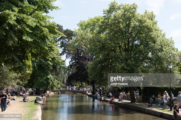A general view the River Windrush in the Cotswolds on a hot summer's day on July 10 2018 in Bourtonon theWater England