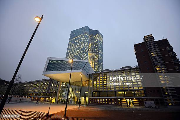 General view to the new headquarters of the European Central Bank and the skyscraper pictured in the twilight on December 4 2014 in Frankfurt am Main...