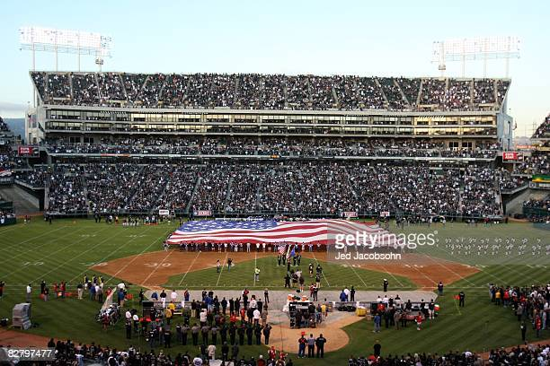 A general view with a flag spread on the field prior to the NFL game between the Denver Broncos and the Oakland Raiders on September 8 2008 at McAfee...