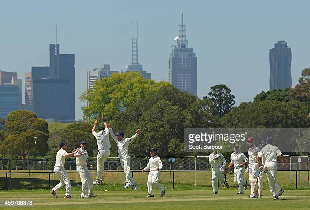 A general view with the city skyline in the background as Carlton celebrate taking a wicket during a match between Carlton and Fitzroy Doncaster 1st...