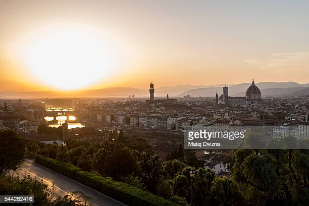 A general view with the Santa Maria del Fiore Cathedral also known as the Duomo Giotto's Campanile and the Palazzo Vecchio during sunset is seen from...