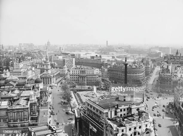 General view with Trafalgar Square and Nelson's Column in the foreground with South Africa House beyond the National Gallery to the left of the image...