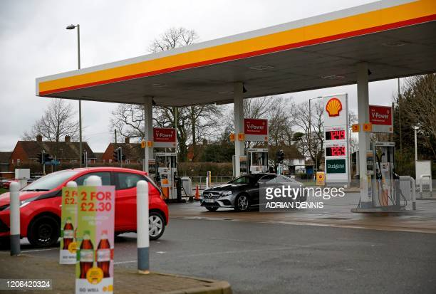 General views of a Shell petrol station is pictured in Farnborough, 40 miles southwest of London on March 10, 2020. - Oil prices jumped more than 7...