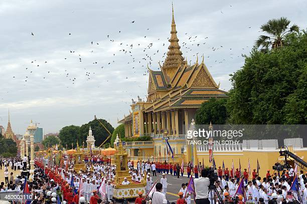 A general views of Cambodian Royal officials march during a procession of the remains of the late former King Norodom Sihanouk in front of the Royal...