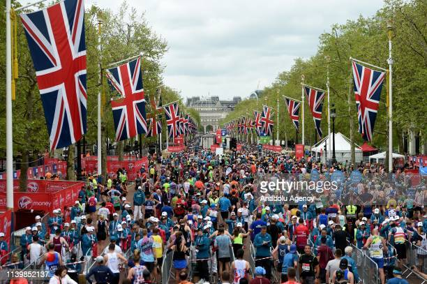 General views of runners near the finish line at the London Marathon in central London on April 28 2019