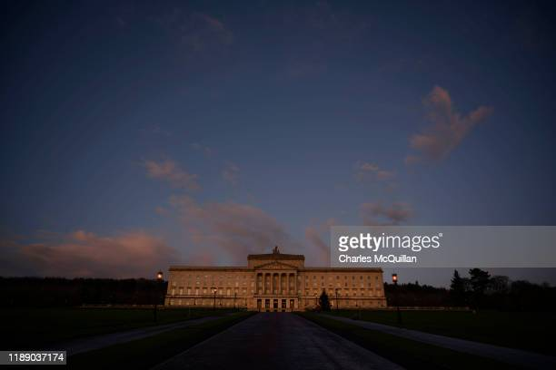 General views of Stormont and Carsons statue as the sun starts to set as cross party talks to restore the Northern Ireland power sharing government...