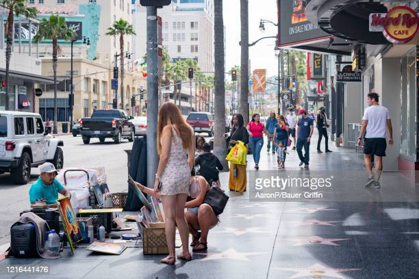 General views of traffic, tourists and shoppers returning to Hollywood Blvd for the first weekend of in-store retail business being open since...