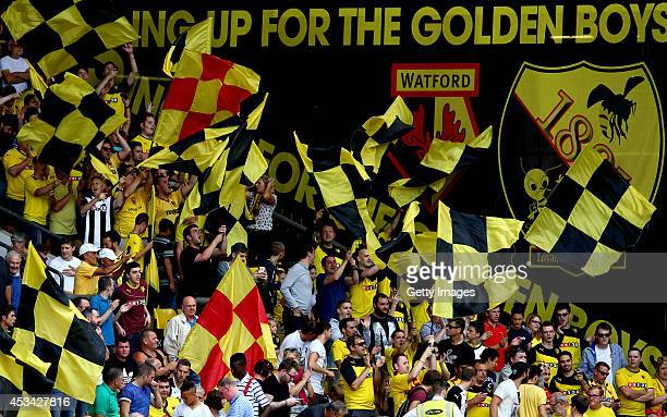 General views of Watford fans waving flags during the Sky Bet Championship match between Watford and Bolton Wanderers at Vicarage Road on August 9...