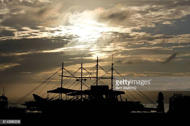 General views shows a traditional port in the city of Ternate, in Indonesia's Maluku Islands, on March 9 prior to a total solar eclipse. A total...