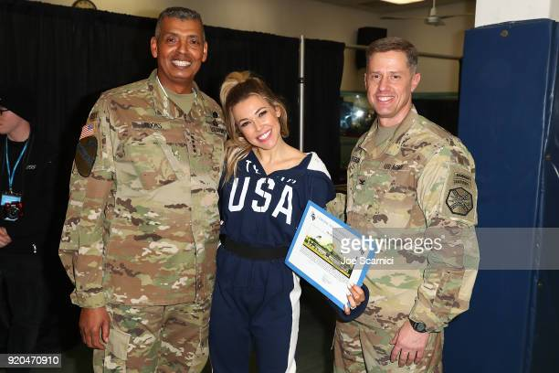 S General Vincent Brooks Singer Rachel Platten and Major Brooks pose for a photo durint the Team USA WinterFest Presented by Hershey's on February 19...