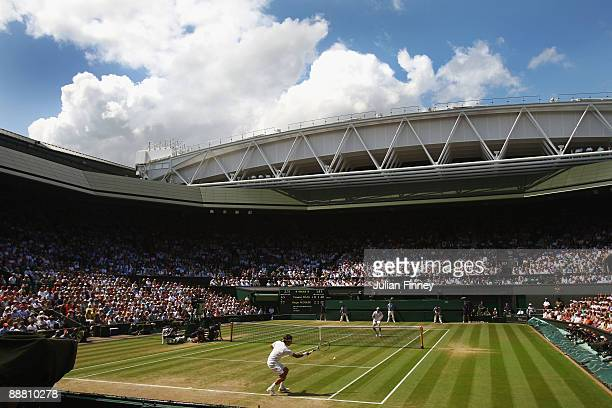 A general voew of Centre Court as Roger Federer of Switzerland plays a forehand during the men's singles semi final match against Tommy Haas of...
