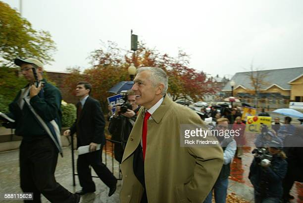 General Wesley Clark campaigns for President of the United States door to door visiting residents and businesses along Main Street in Nahua Clark is...