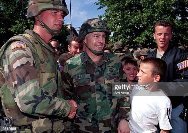 General Wesley Clark greets Kosovars June 19 1999 in Ferizaj Kosovo Yugoslavia American troops are securing this sector of Kosovo