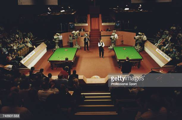 General wide view of play in the 1993 Embassy World Snooker Championship with Dennis Taylor pictured about to play a shot at the Crucible Theatre in...