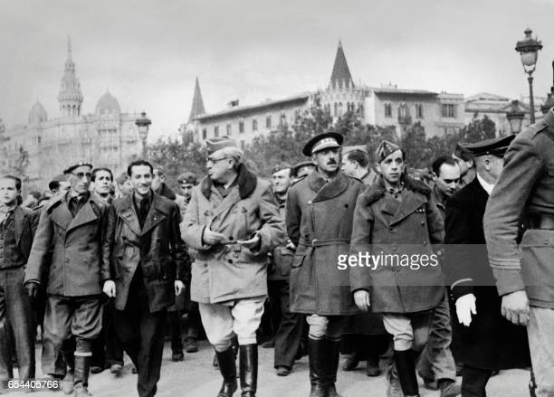 General Yagüe marchs victoriously through Barcelona on January 30 four days after his troops had taken control of the city The city's fall to the...