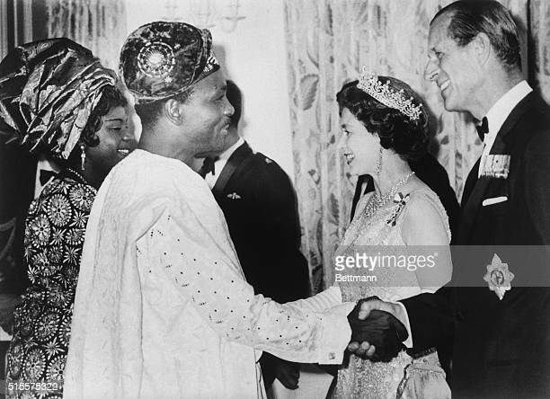 HE General Yakuba Gowon Head of Federal Military Government of Nigeria and his wife are shown with Queen Elizabeth II and Prince Philip at a...