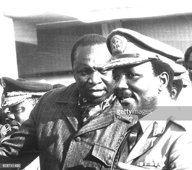 General Yakubu Gowon who is reported to have been ousted as Nigeria's Head of Government in a military coup talking with Uganda's President Idi Amin...
