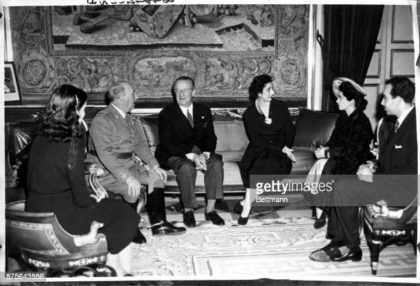 Generalissimo and Senora Franco are shown in their home at El Pardo Palace as they received the sister of the Shah of Iran Princess Pahlevi and her...