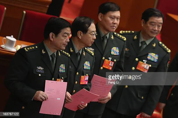 Generals of Chinese People's Liberation Army Chang Wanquan Fang Fenghui Zhang Yang and Zhao Keshi line up to cast their votes into a box during the...