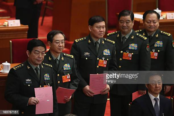 Generals of Chinese People's Liberation Army Chang Wanquan Fang Fenghui Zhang Yang Zhao Keshi and Zhang Youxia line up to cast their votes into a box...