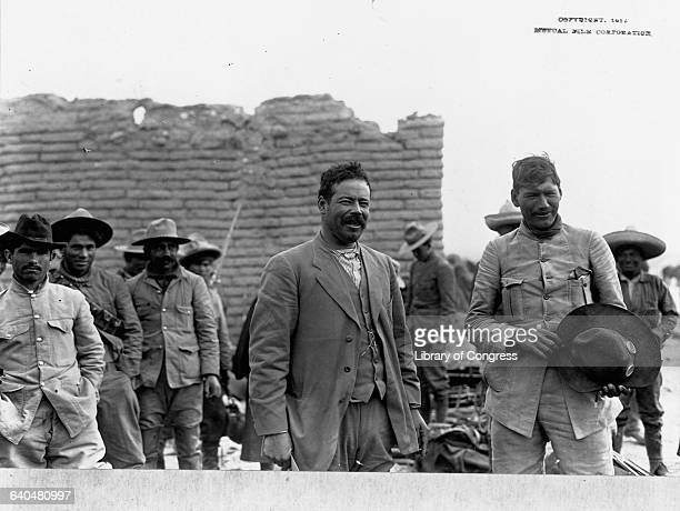 Generals Pancho Villa and Panfilo Natera stand with a group of Mexican rebels during the Mexican Revolution in 1914.
