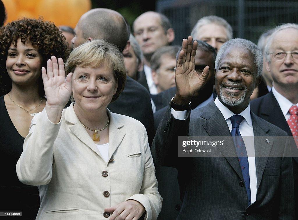 U.N. General-secretary Kofi Annan (R) and German Chancellor Angela Merkel wave during an opening ceremony on July 11, 2006 in Bonn, Germany. Annan and Merkel inaugurated the United Nations campus, the German U.N. headquarters, in the former West German capital of Bonn.
