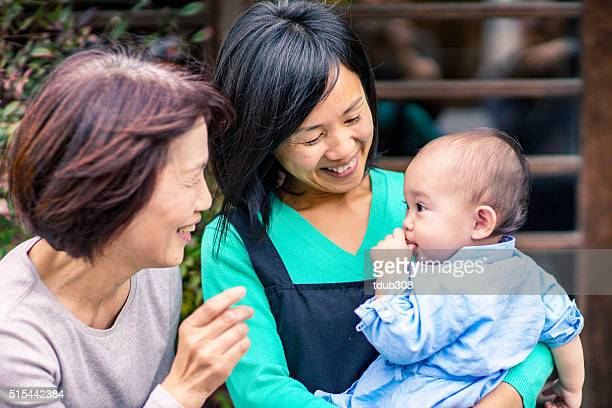 3 generation family outside cafe