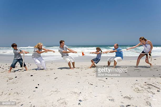 Generation family playing a game of tug of war