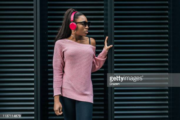 Generation Z African descent woman with headphones.
