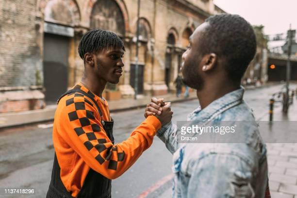 Generation Z - African ethnicity youth handshake - United Kingdom
