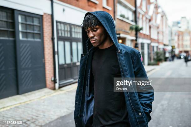 Generation Z black male with hood  in UK with Afro hairstyle