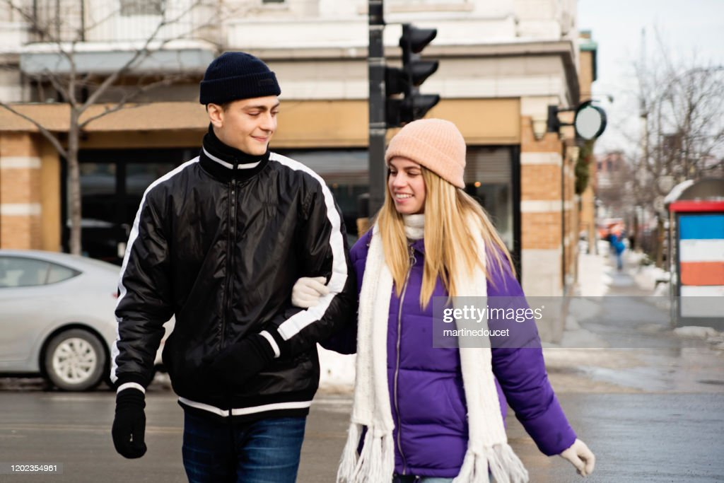 Generation Z couple crossing street in winter. : Stock Photo