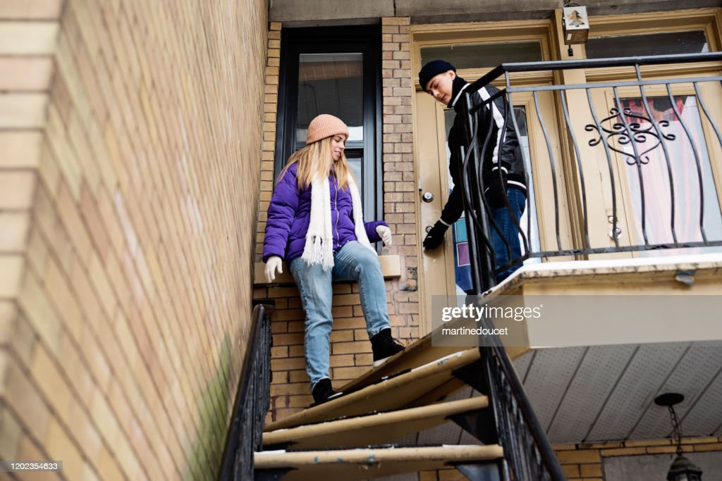 Generation Z couple getting out their appartement in winter. : Stock Photo