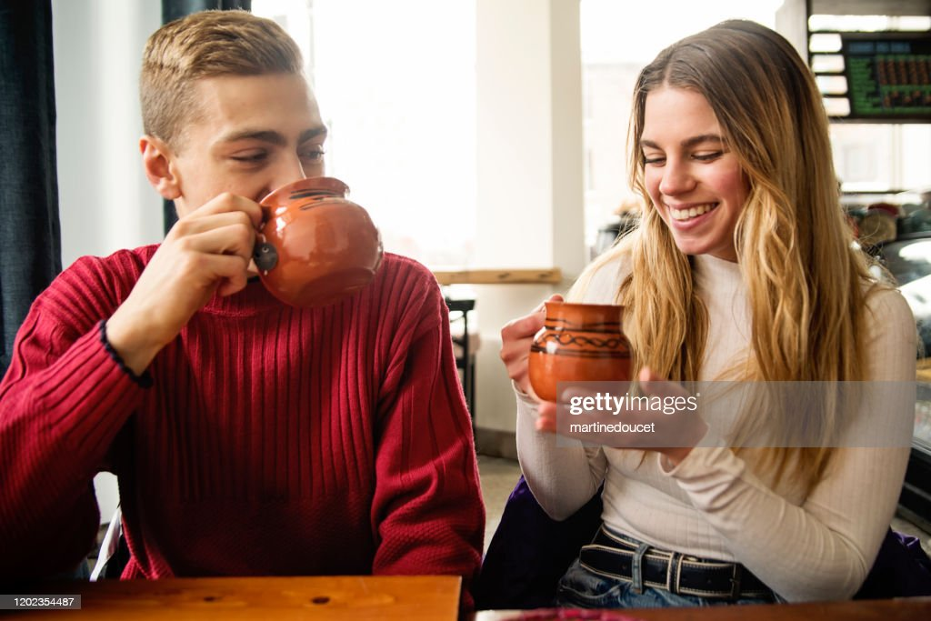 Generation Z couple leisure time in coffee shop. : Stock Photo