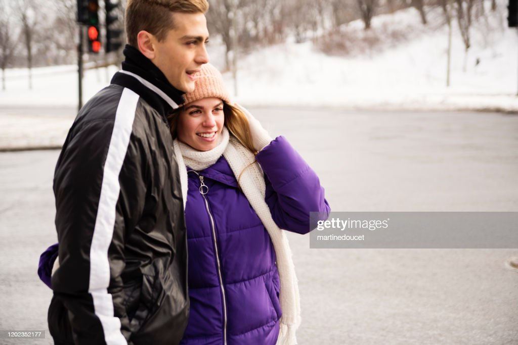 Generation Z couple waiting on street corner in winter. : Stock Photo