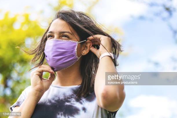 generation z female wearing face mask and social distancing - applying stock pictures, royalty-free photos & images