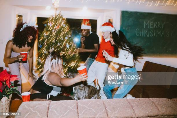 generation z friends christmas dance party - twerking stock photos and pictures