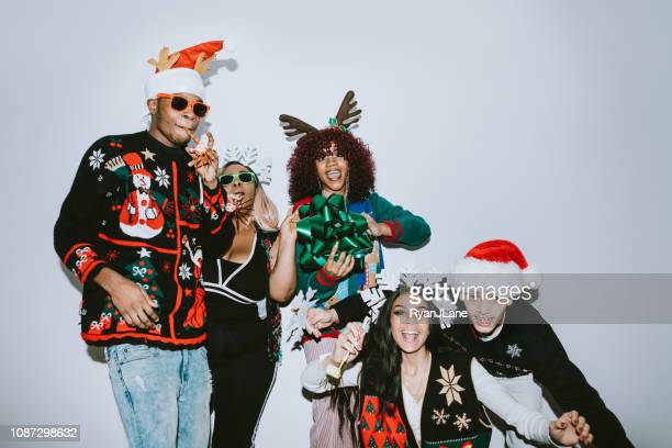 generation z friends christmas photo booth - sweater stock pictures, royalty-free photos & images