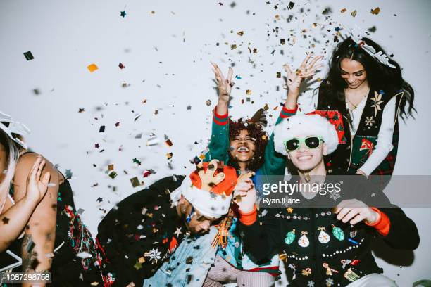 generation z friends christmas photo booth - christmas party stock photos and pictures
