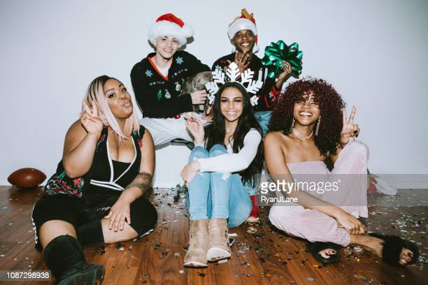 generation z friends christmas photo booth - ugly christmas sweater party stock pictures, royalty-free photos & images