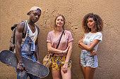 portrait three young multiethnic friends city