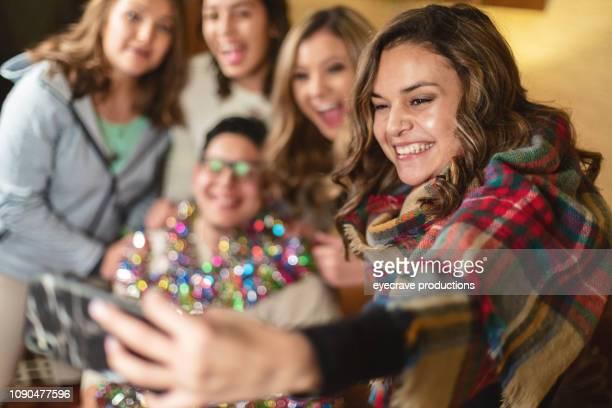 Generation Z Hispanic and Mixed-Race Christmas Party Holiday Season Celebration