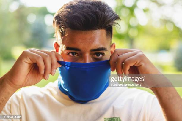 generation z hispanic athletic male wearing face mask - eyecrave  stock pictures, royalty-free photos & images