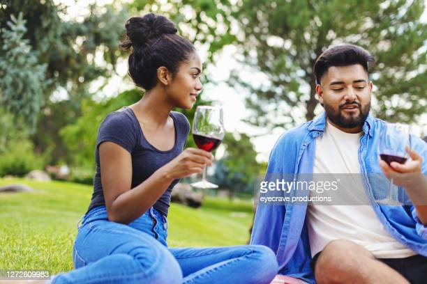 generation z male and female pic nic outing in summer drinking wine outdoors - eyecrave  stock pictures, royalty-free photos & images