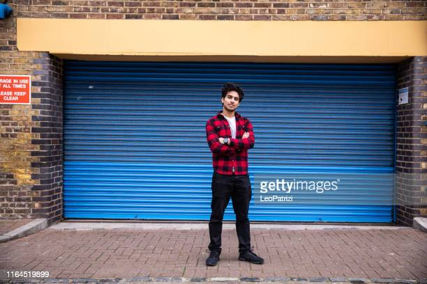 generation z teenager posing in the street in london city - indian ethnicity stock pictures, royalty-free photos & images